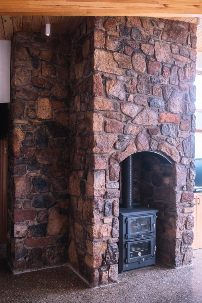 Tuft house stone fireplace